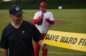 Dave Ward receives temporary plaque during field naming ceremony