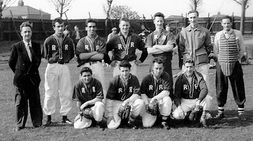 """Back row: Dave Robinson (chairman), Harold Waterson, Billy Coates (catcher), Gordon Acaster, Ron """"Lofty"""" Marshall (pitcher), and the umpire for the game. Front row: Les Smith, Colin Arnold, Norman Angell, and Dennis Woods. The team's colours were red and white, and in this picture white was predominant.  A couple of seasons earlier, red was the main colour but the kit faded and so the scheme was changed."""